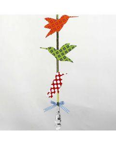 Uro med fugle af mønstret papir på pailletbånd