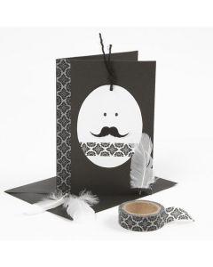 Påskekort i sort og hvidt dekoreret med masking tape og fjer