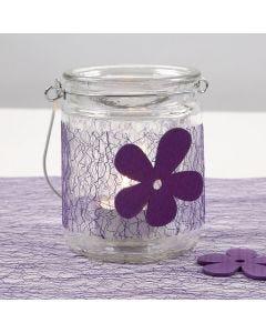 Lysglas dekoreret med lilla netbordløber og træblomst