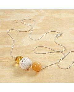 Perler på lang sølvkæde