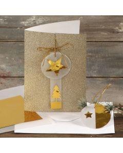 Julekort med glitter pyntet med guldstjerne og juletræ på vellumpapir