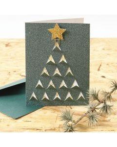 Kort med grafisk julemotiv skåret ud på forsiden