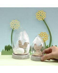 Klokke dekoreret med saml-selv påske træfigurer, æg og hvide fjer