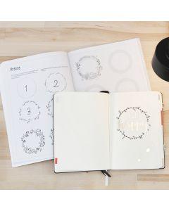 Bullet journal med motiver fra et øvehæfte