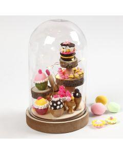 Klokke med mini cupcakes som indvendig pynt