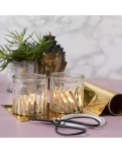 Lysglas pyntet med striber af guld dekorationsfolie