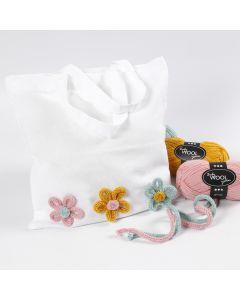 Mulepose pyntet med blomster lavet af tubestrik