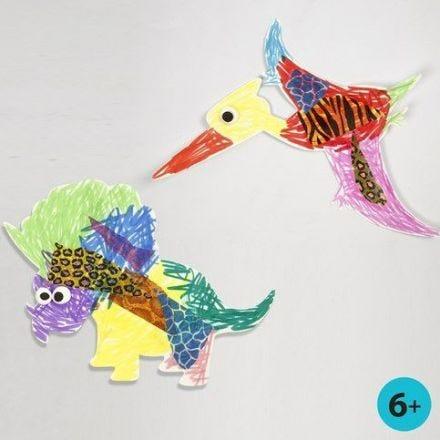Dinosaur og flyveøgle af hvidt karton, malet og pyntet
