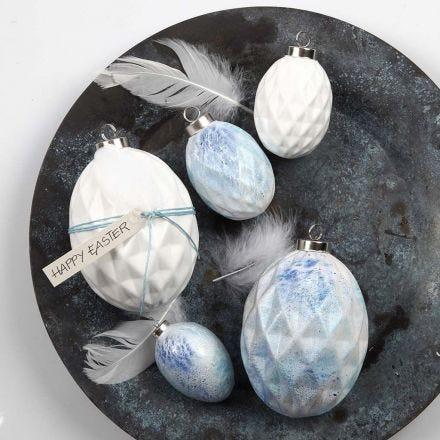 Sprøjtemalede æg af terrakotta