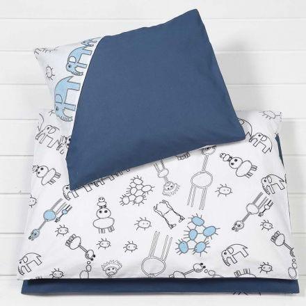 Sengetøj til babydyne og pude af stof med farvelagte motiver