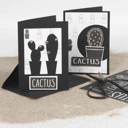 Dobbeltkort dekoreret med udskæring og designpapir