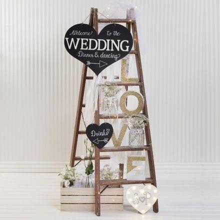 Dekorationsord pyntet med glimmer og andet bryllupspynt