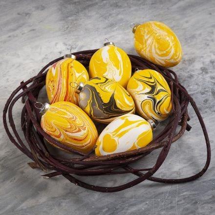Æg af terrakotta dekoreret med marmoreringsfarve