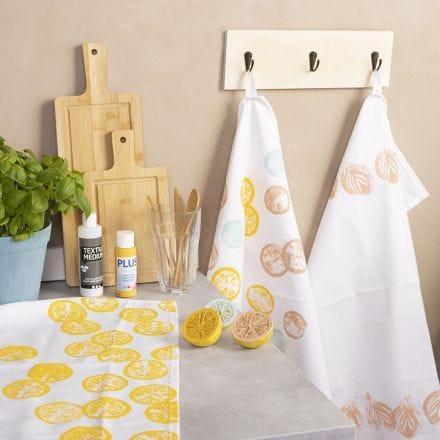 Stempeltryk på tekstil med frugt og grønt