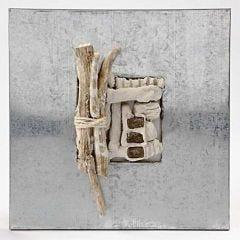 Indrammet collage af naturmaterialer i pulp