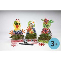 Karsebakker med påskemotiver dekoreret med decoupage og blomster af karton