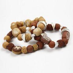 Keramikperler på elastisk smykketråd