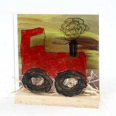 Traktor i landskab på 3D plade med glas