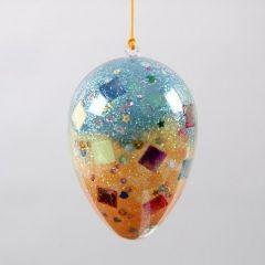 Todelt klart påskeæg dekoreret indvendigt med pailletter og glitter