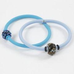 Armbånd af silicone med stopringe om perle