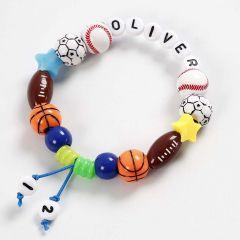 Armbånd er farvet elastiksnor med bl.a. bogstavperler