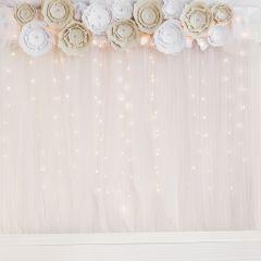 Blomster til dekoration og fotobaggrund til festen