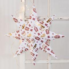 Stor julestjerne foldet i designpapir med nøddeknækker motiv