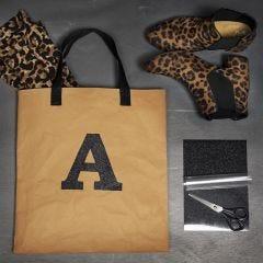 Strygestof på taske af læderpapir