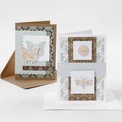 Kort pyntet med designpapir og udstansede motiver med dekorationsfolie