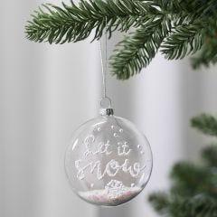 Flad glaskugle dekoreret med sne effekt