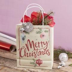 Gavepose med julemotiv pyntet med stjerne, lametta og silkepapir