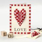 Valentinskort med påsyet hjerte og stemplet tekst