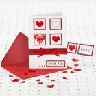 Bryllupsinvitation i rød og hvid med hjerter, bånd og rhinsten