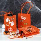 Trick or treat pose dekoreret med hobbymaling, stempeltryk og øjne som klistermærker
