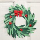 Julekrans af udklippede hænder af karton med Silk Clay pynt
