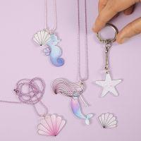 Havfrue og havdyr smykker og nøglering af krympeplast