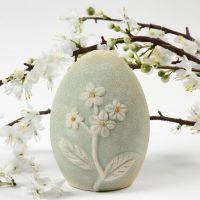Æg i terrakotta med blomstermotiv