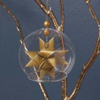 Flettet julestjerne i glasklokke