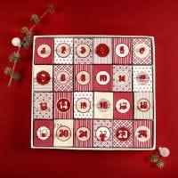Julekalender af 24 æsker dekoreret med decoupagepapir og stickers