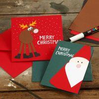 Kort med julemotiver af julemand og rensdyr i karton