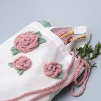 Mulepose pyntet med roser lavet af tubestrik