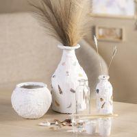 Vase med gipsoverflade og mosaik